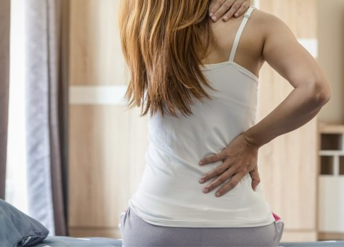 Woman experiencing aches and pains
