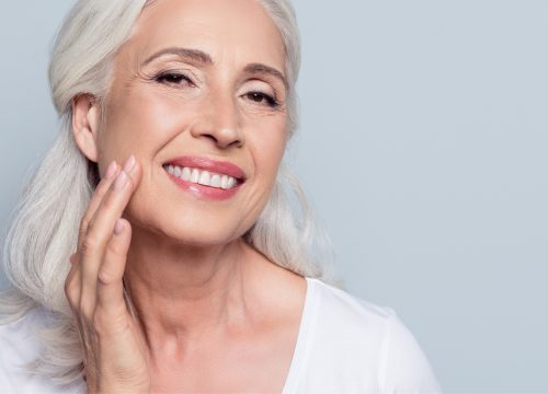 Older woman interested in skin tightening treatments