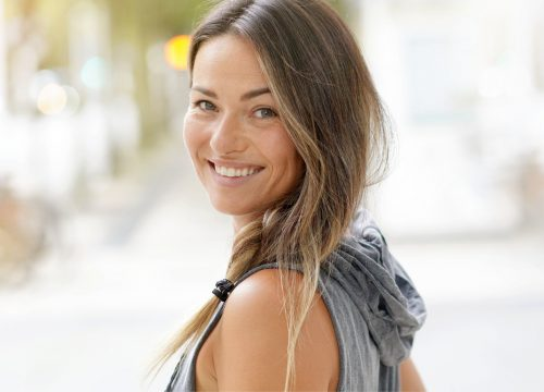 Happy woman after SoLá Infrared Therapy