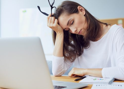 Woman experiencing stress at work